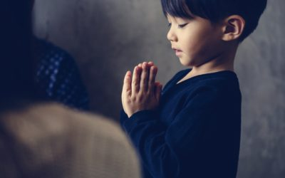 Japanese boy praying