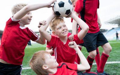 Football Team Cheering Holding Ball