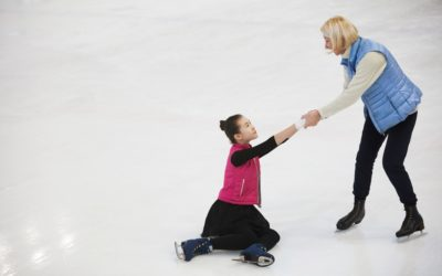 Woman Helping Girl Get up